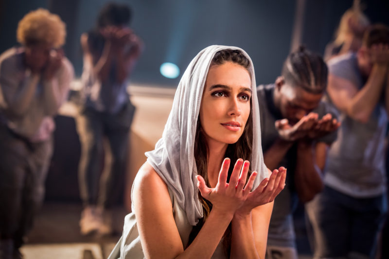 Mary Magdalene prays alongside the chorus